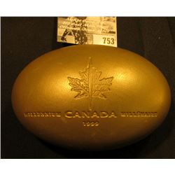 """1999 """"August"""" Canada Silver Proof Quarter in original football shaped box."""