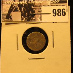 986 . 1858 U.S. Three-Cent Silver, VF, but bent.