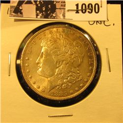 1090 . 1885 P U.S. Morgan Dollar, Uncirculated. Nice attractive gold toning.