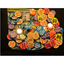 1671 . Large Zip lock bag full of Political, Advertising, and miscellaneous Pin-backs.