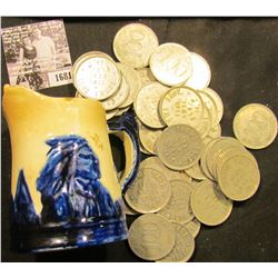 """1681 . Small Sleepy Eye Cream Pitcher. Part of Spout missing. """"42s""""; & (37) """"Good For/$1.00/In Trade"""