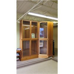 "Angled Tall Glass Cabinets, 103"" H, Two Left Panels 49"" W Combined, Right Panel 28"" W, Approx. 18"" D"