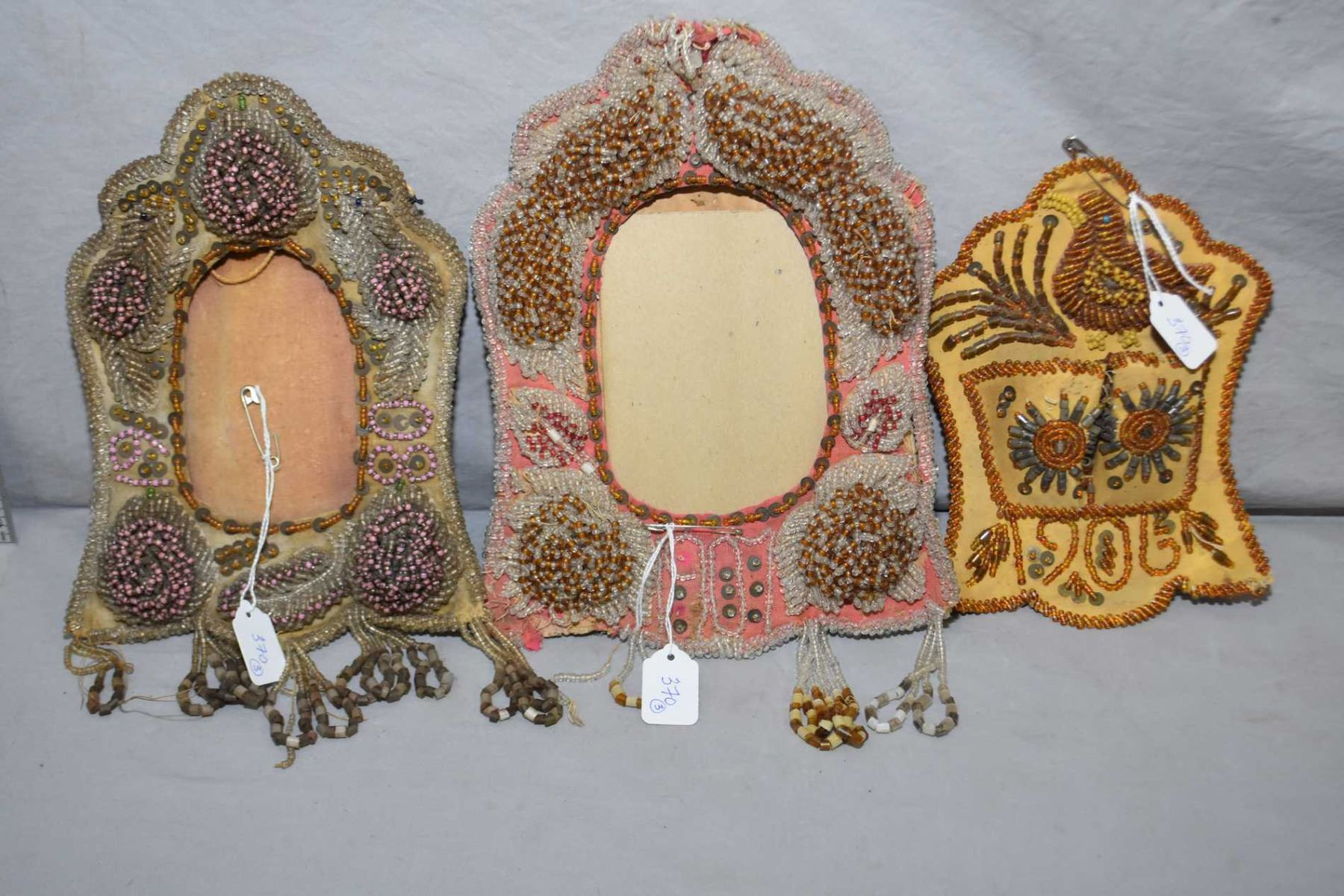 Two Native American beaded picture frames, dated 1907 and 1908 and a ...