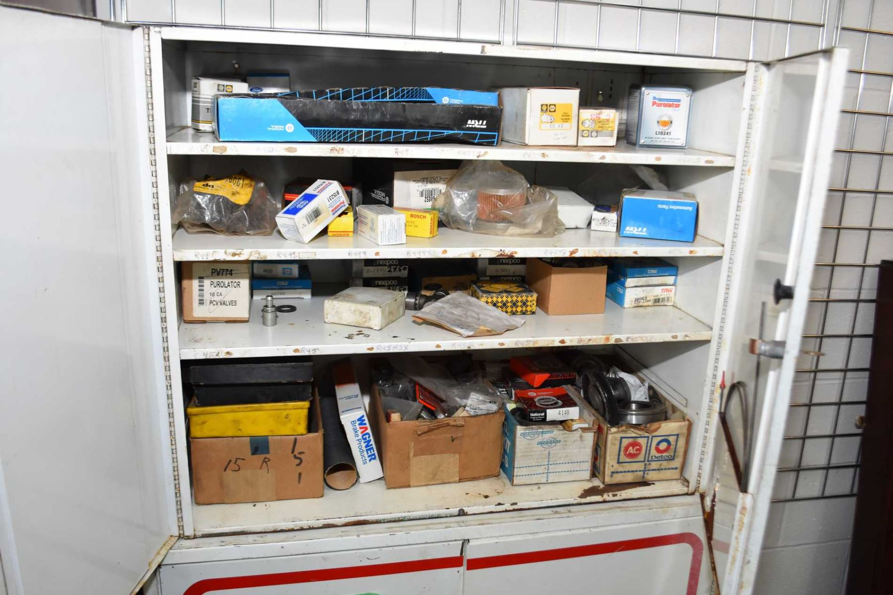 Two door metal wall hanging cabinet and contents including brake ...