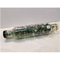 Marbles in glass rolling pin