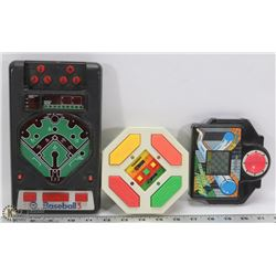 THREE ASSORTED VINTAGE HAND HELD ELECTRONIC GAMES