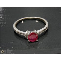 .925 SILVER RING W/CZS AND PINK STONE -