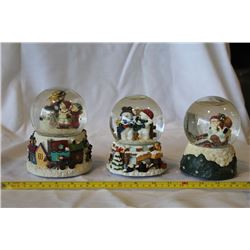 Set of 3 musical snow globes - one with santa, one with 2 snowman, one with carolers