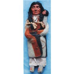 Skookum mother with papoose and beads