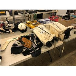 LOT OF SPORTS EQUIPMENT INC. PAIR OF REEBOK GOALIE PADS, BASEBALL GLOVE, HOCKEY SHOULDER PADS AND