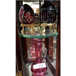CRANBERRY GLASS PITCHER & 2 RUBY CUT TO CLEAR CRYSTAL EGGS ON STANDS