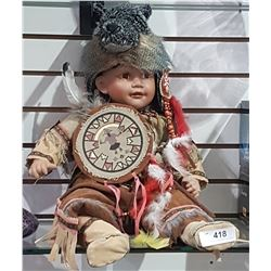 NATIVE CHILD PORCELAIN DOLL