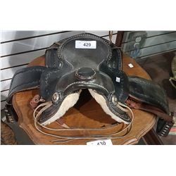 SMALL DECORATIVE LEATHER SADDLE