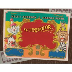 Dumbo production title background featuring clowns and circus animals.