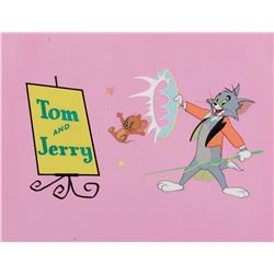 """""""Tom"""" and """"Jerry"""" production title cel on a matching production background from Cartoon Carnival."""