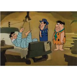 """""""Fred Flintstone"""", """"Rock Slag"""" and """"Chief Boulder"""" production cels from The Man Called Flintstone."""
