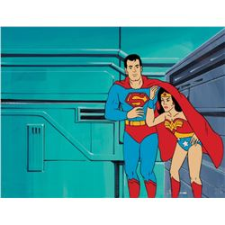 """Superman"" and ""Wonder Woman"" production cel on a production background from Super Friends."
