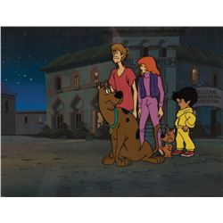 """Scooby-Doo"", ""Shaggy"", ""Daphne"", ""Flim Flam"" & ""Scrappy"" on a production background."