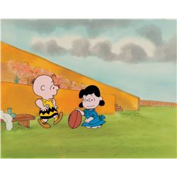 """Charlie Brown"" and ""Lucy"" production cels on a production background from a Peanuts TV special."