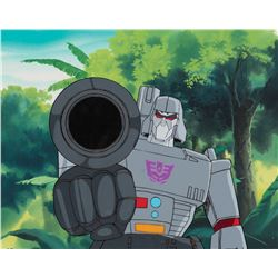 """Megatron"" pointing his weapon production cel on a matching background from The Transformers: G1."