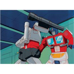 """""""Optimus Prime"""" vs. """"Megatron"""" production cels on a matching background from The Transformers: G1."""