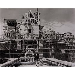 Walt Disney large vintage photograph taken during construction of Sleeping Beauty's Castle.