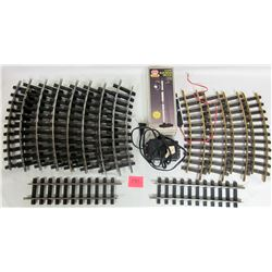 "14 piece ""G"" scale train track, transformer, railroad signal"
