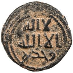 UMAYYAD: Anonymous, ca. 705-715, AE fals (3.65g), Tanukh, ND. VF