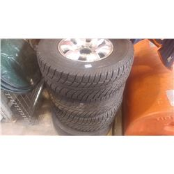 SET OF FOUR NISSAN 265 70R15 TIRES ON RIMS