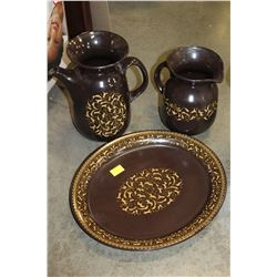 TWO CERAMIC PITCHERS AND TRAYS
