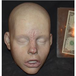 SILICONE DEAD CHILD HEAD WITH WOUNDS