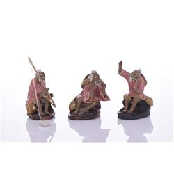 Three Chinese Mud Men Glazed Figures of Fishermen.
