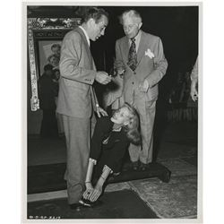 Humphrey Bogart (4) photographs from his footprint ceremony at Grauman's Chinese Theatre.
