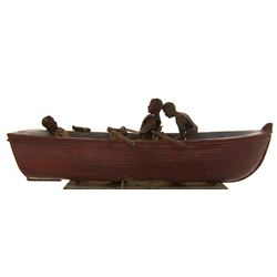 Mutiny on the Bounty miniature mechanical boat and rowing sailors.