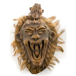 Tribal lion shield prop from South Pacific.