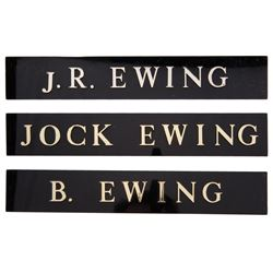 """Bobby Ewing"", ""J.R. Ewing"", and ""Jock Ewing"" nameplates from Dallas."