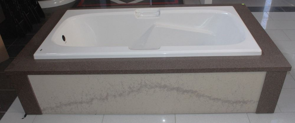 KOHLER HYTEC BATHTUB WITH STONE COVERED SURROUND