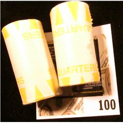 Pair of Bank-wrapped rolls of Vending Machine tokens.  I have never broke the rolls to see what trea