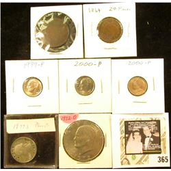 Possibly 1805 U.S. Large Cent (very weak date); 1864 U.S. Two Cent Piece; 1999 P, (2) 2000P Roosevel