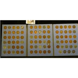 Group of Lincoln Cents in a blue Whitman folder, contains multiples of the WW II Steel Cents.