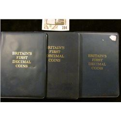 """(3) Five-piece Sets in vinyl holders of """"Britain's First Decimal Coins""""."""