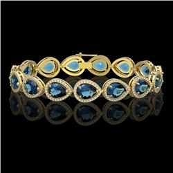 21.06 CTW London Topaz & Diamond Halo Bracelet 10K Yellow Gold - REF-293M3H - 41272