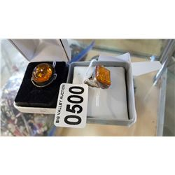 TWO STERLING AND AMBER RINGS