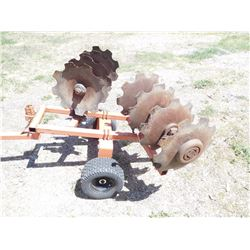 TOW BEHIND CULTIVATOR ON METAL FRAME