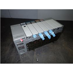 ALLEN BRADLEY 1746-A7 7-SLOT RACK W/ 5 MODULES