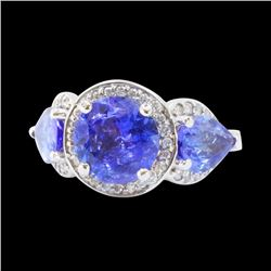 5.6CT NATURAL TANZANITE 14K W/G RING