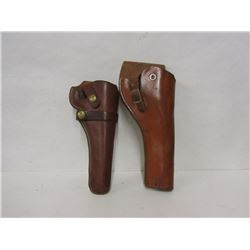 THREE LEATHER GUN STRAPS & TWO PISTOL HOLSTERS