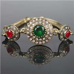 BRACELET - VINTAGE STYLE CRAFTING OF EMERALD LIKE GEM IN GERMAN STERLING SILVER SETTING WITH 18K GOL