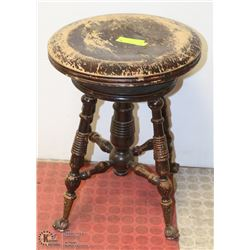 ANTIQUE PIANO STOOL WITH CLAW FEET, STAMPED