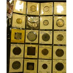 Plastic page with (14) various denomination Israel Coins, most of which are high grade; 1940 Indo Ch